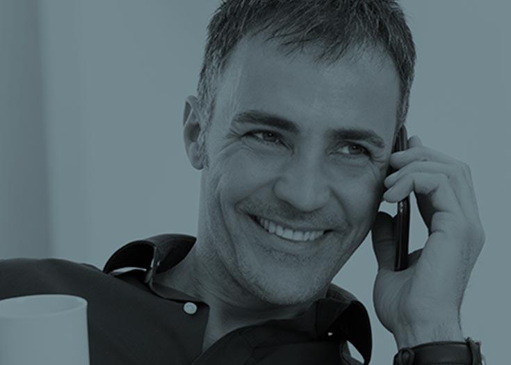 Smiling guy talking on phone